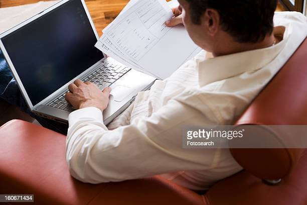 Man Working on laptop in modern living room