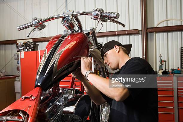 Man working on motorcycle
