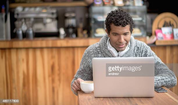 Man working online at a coffee shop