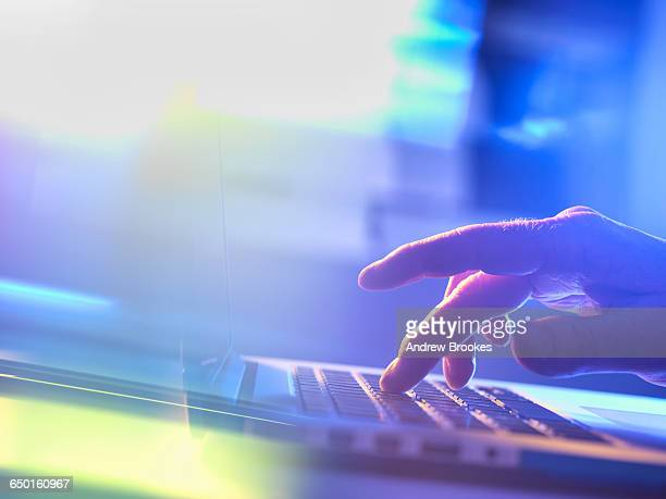 Man working online at a laptop computer