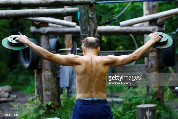 A man working out in a handmade outdoor gym in Moscow's Timiryazevsky Park Russia on July17 2017 The outdoor gym exists since 2012 all the exercise...