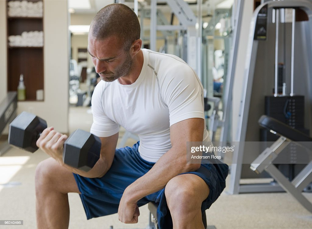 Man Working Out In Gym With Weights Stock Photo | Getty Images