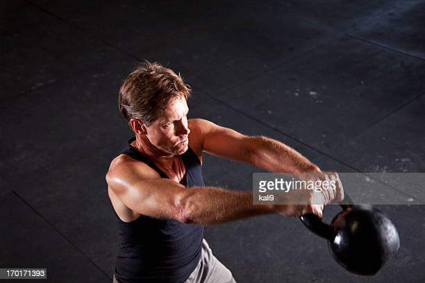 Man working out with kettle bell