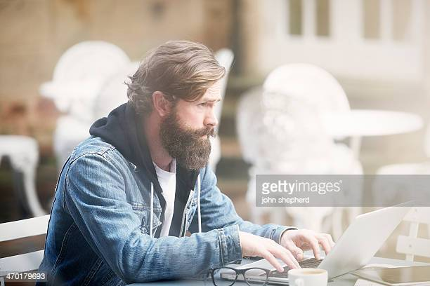 Man working outdoors at a coffee shop