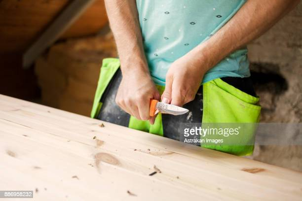 Man working to renovate old attic