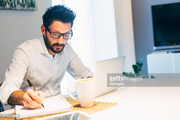Man working using laptop at home