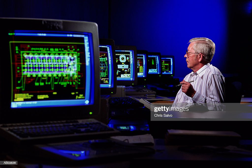 Man working with CAD computers : Stock Photo