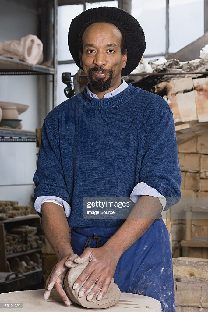 Man working with clay : Stock Photo