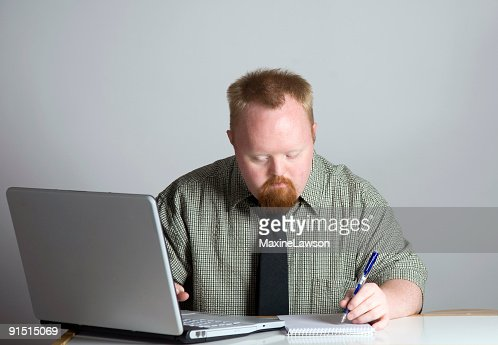 [Image: man-working-with-pencil-and-paper-next-t...?s=170667a]