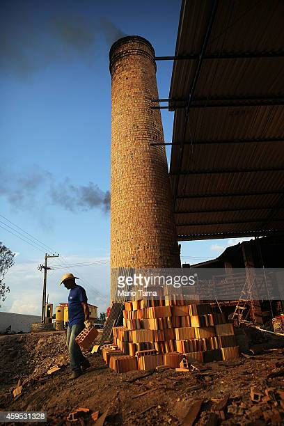 A man works at a ceramics plant that is heated with Amazon wood in a deforested section of the Amazon basin on November 21 2014 in Ze Doca Brazil The...