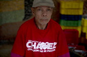 A man works at a Mercal a staterun market that provides subsidised food and basic goods in a street of Caracas on October 03 2012 The Mercal is one...