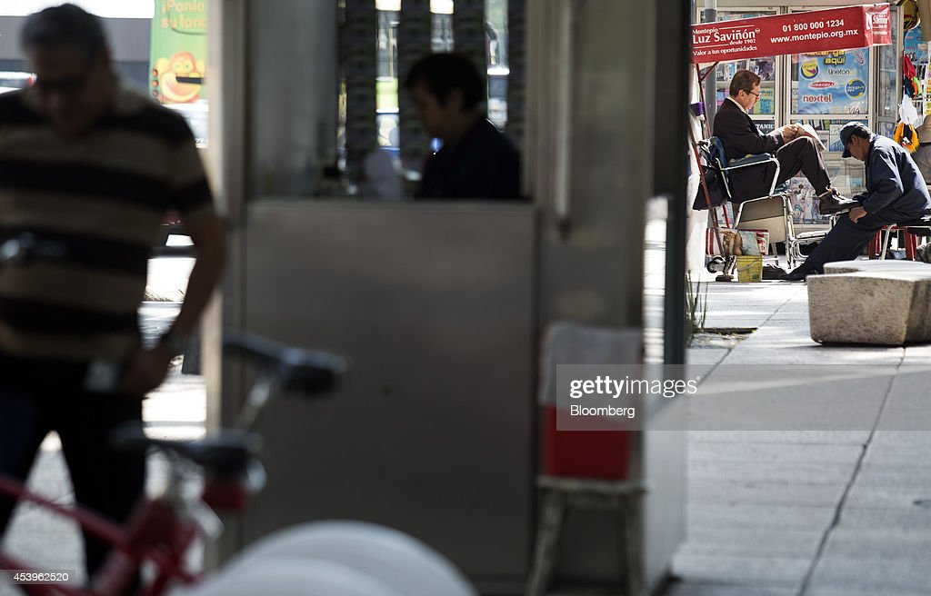 A man works at a shoe shine stand on Reforma Avenue in Mexico City, Mexico, on Thursday, Aug. 21, 2014. Mexican consumer prices rose more than analysts expected in the first half of August and the unemployment rate rose to 5.47 percent in July compared with 4.8 percent in June. Photographer: Susana Gonzalez/Bloomberg via Getty Images
