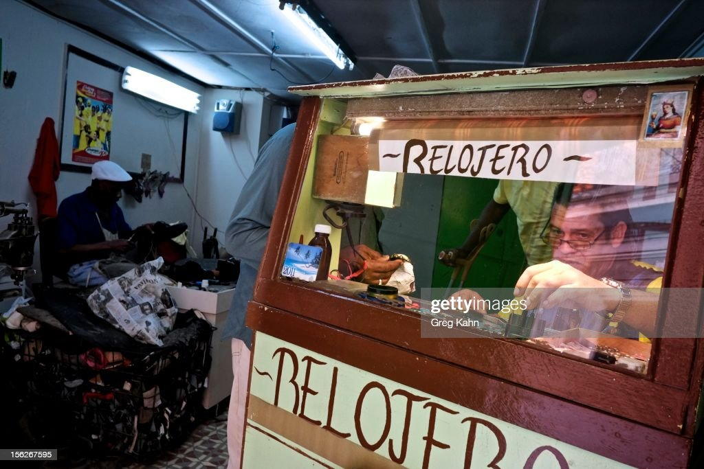 A man works at a watch and shoe repair shop in Old Havana November 12, 2012 in Havana, Cuba. New business regulations in the communist country have allowed thousands of citizens to make money for themselves for the first time since 1959.