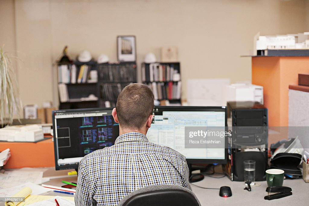 Man works at computer : Stock Photo