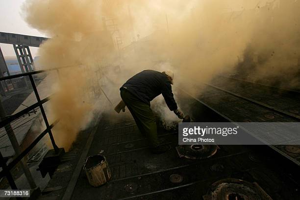 A man works at the coke furnace at the Xian Coking Factory which will be shut down while the local government launches a campaign to reduce air...