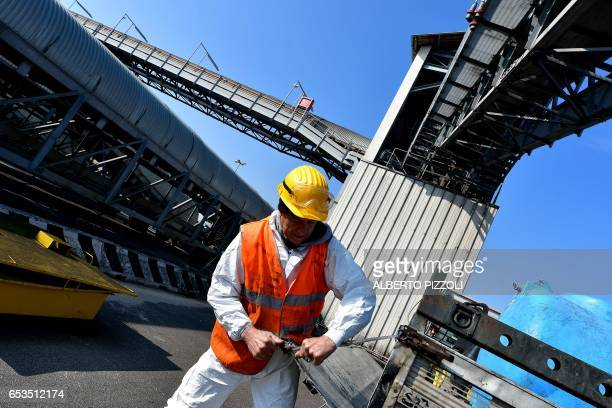 A man works at the commercial dock of French sugar cooperative Cristal Union after sugar was unloaded at the SFIR Raffineria di Brindisi sugar...