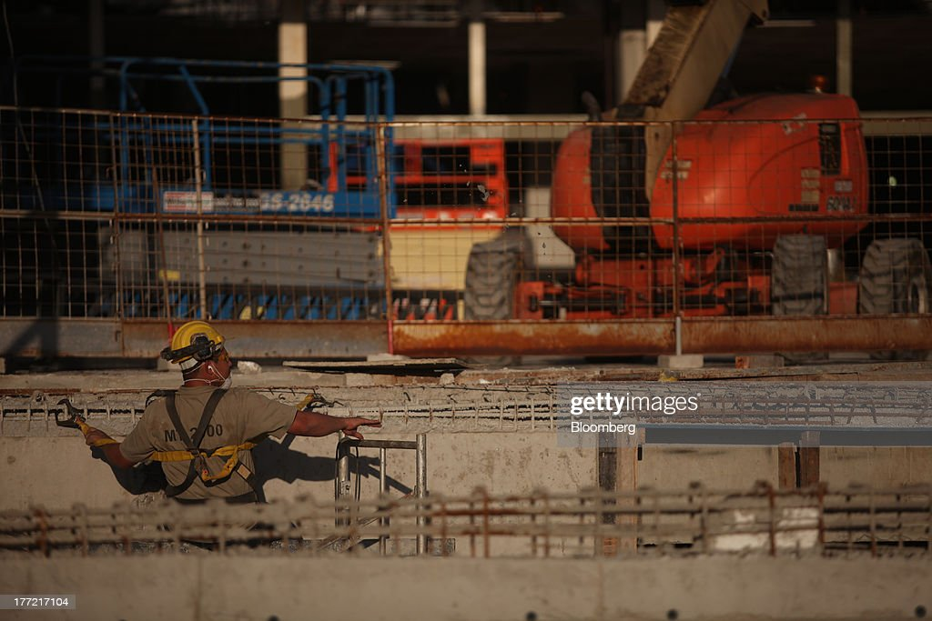 A man works at the Metropolitano Barra Shopping center under construction in Rio de Janeiro, Brazil, on Wednesday, Aug. 21, 2013. Latin America's largest economy created 7,154 manufacturing jobs and 4,899 construction jobs in July, down from 24,718 and 25,433 new posts a year ago. Photographer: Dado Galdieri/Bloomberg via Getty Images