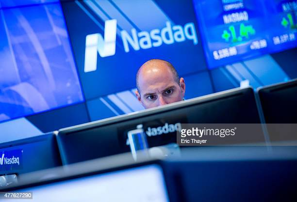 A man works at the NASDAQ exchange in New York City June 18 2015 The Nasdaq Composite rose 13% Thursday to an intraday record of 514332 above the...