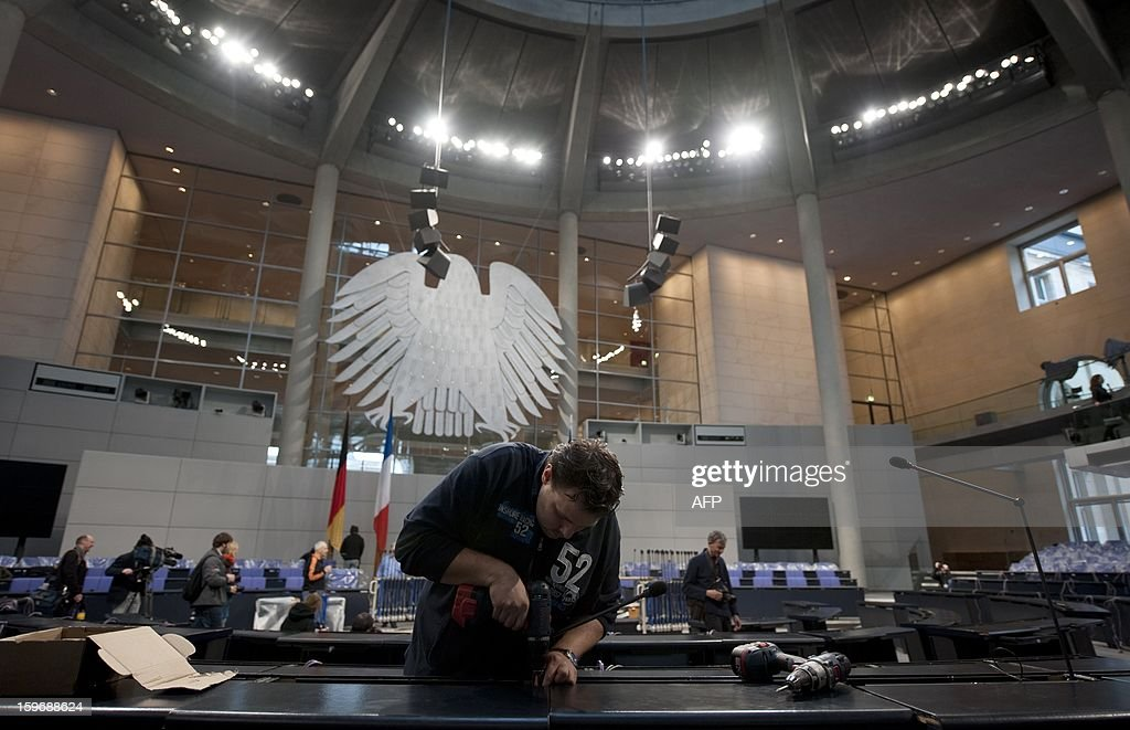 A man works at the plenary hall of the Bundestag (lower house of parliament) on January 18, 2013 in Berlin. Germany and France will be celebrating the 50th anniversary of the Elysee Treaty on January 22, 2013, among others with a common session of German and French delegates at the German Bundestag.