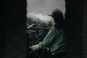 A man works at the Xian Coking Factory which will be shut down while the local government launches a campaign to reduce air pollution February 2 2007...
