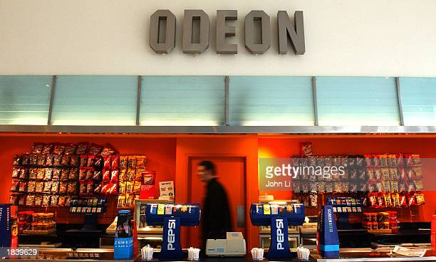 A man works behind the counter at the Odeon West End Cinema in Leicester Square March 10 2003 in London A syndicate led by German investment bank...