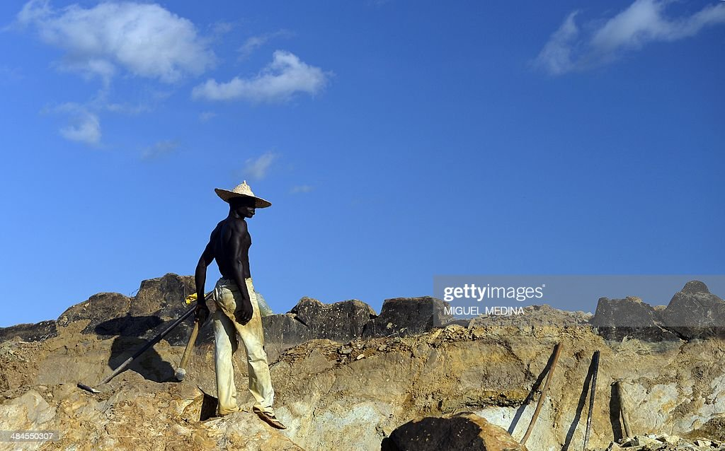 A man works in a stone pit from which the stones will be sold at Sao's market, a few kilometers from Bangui, in Central Africa on April 12, 2013. AFP PHOTO / MIGUEL MEDINA