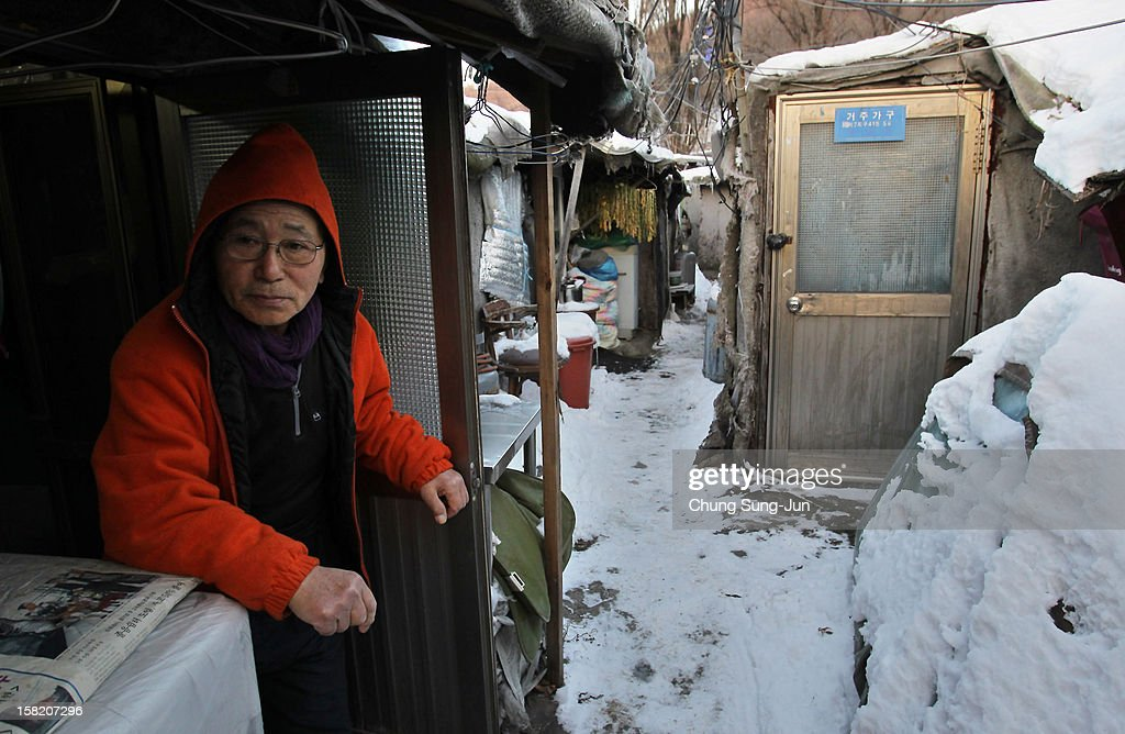 A man works in Guryong slum on December 11, 2012 in Seoul, South Korea. Located near South Korea's wealthiest Gangnam district, Guryong slum was established in 1988. With about 3,000 residents, Guryong is now the largest slum settlement in Seoul where most residents are elderly and living in poverty. One of the main South Korean presidential election campaign issues is the economy, as the chaebol, South Korea's business conglomerate, dominates the country's wealth while the economic life of middle class people has not been improving.