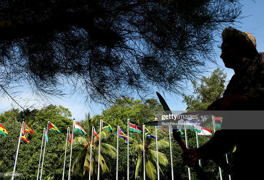 A man works in the garden lined with national flags ahead of the Commonwealth Heads of Government Meeting (CHOGM) at Bandaranaike Memorial International Conference Hall (BMICH) on November 9, 2013 in Colombo, Sri Lanka. The bi-annual gathering of Commonwealth leaders will take place in the Sri Lankan captial, Columbo, November 15-17. CHOGM will move forward despite some human rights groups urging leaders to boycott the meetings until Sri Lanka further investigates charges of war crimes. Canadian Prime Minister, Stephen Harper has already confirmed he will not attend.