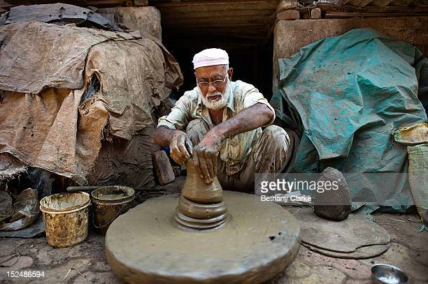 A man works in the Kumbharwada pottery area of Dharavi November 4 2011 in Mumbai India Dharavi Asia's largest slum situated in the centre of Mumbai...