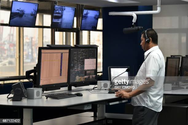 A man works in the vessel traffic service control room at Tanjung Priok port in Jakarta on May 23 2017 The port's vessel traffic service makes use of...