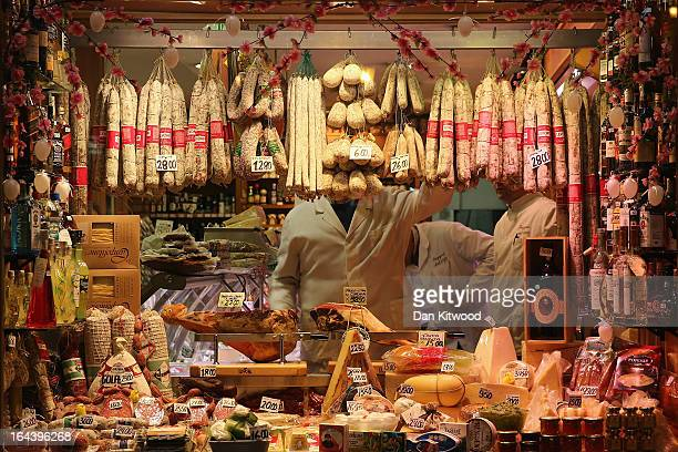 A man works inside a deli in Campo de' Fiori on March 23 2013 in Rome Italy Today near Rome Pope Francis and Pope Emeritus Benedict met for a private...