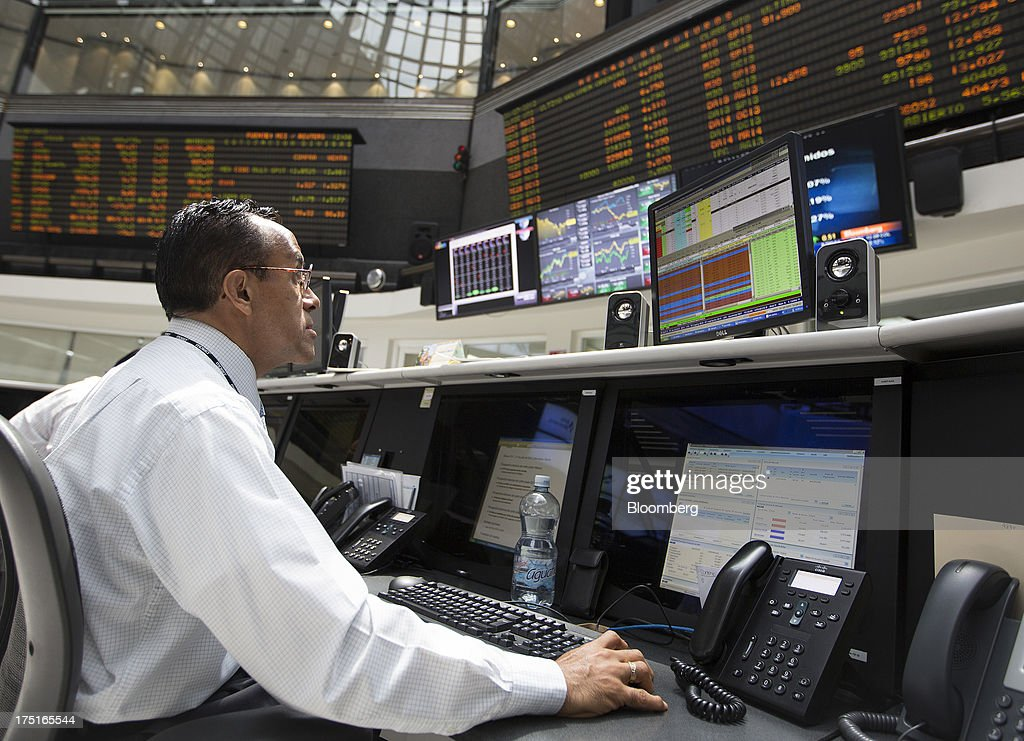 A man works on a computer on the trading floor at the Bolsa Mexicana de Valores (BMV), Mexico's stock exchange, in Mexico City, Mexico, on Wednesday, July 31, 2013. Mexico's economy is forecast to grow 2.8 percent this year based on analyst estimates compiled by Bloomberg. Photographer: Susana Gonzalez/Bloomberg via Getty Images