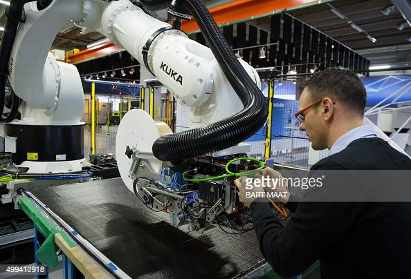 A man works on a machine in the first Dutch digital fabric of carbon plates aimed at the aircraft industry initiated by Siemens and Airborne on...