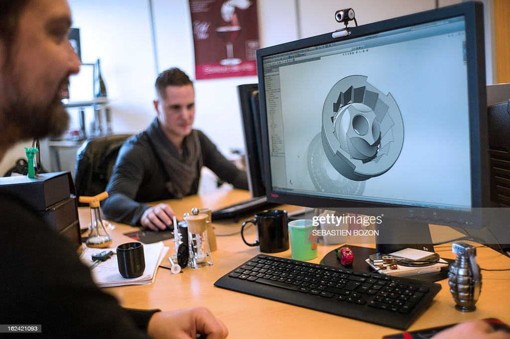 A man works on a peppermill mechanism on a computer at PSP Peugeot (Poivrières Salières Production) peppermill workshop on February 22, 2013, in Quingey (eastern France).