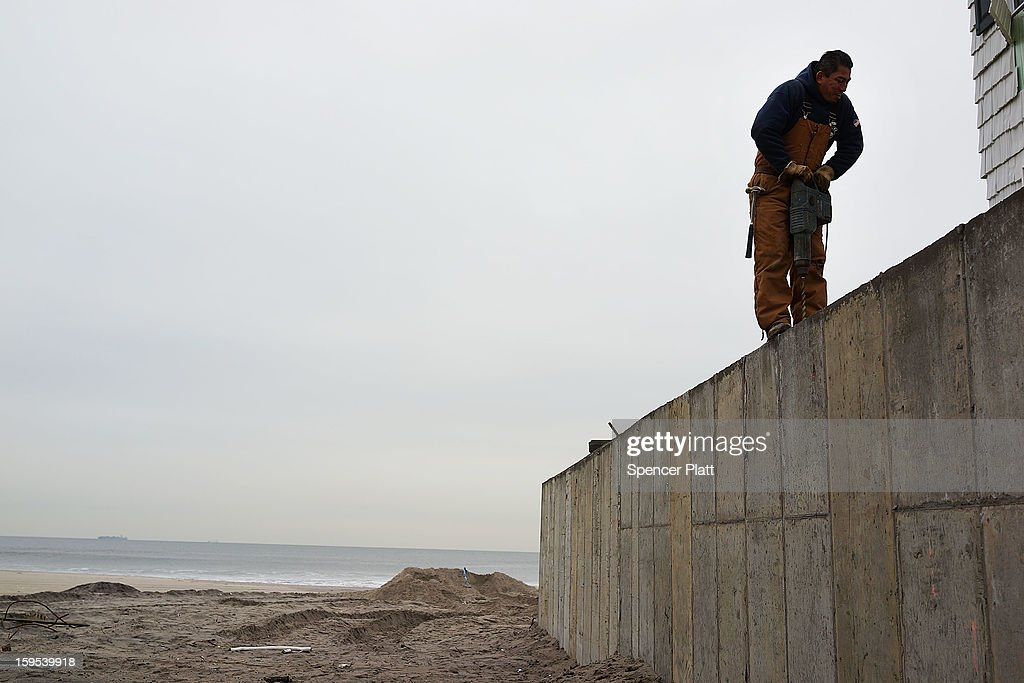 A man works on a protective wall near homes damaged by Hurricane Sandy along the beach in the Rockaways on January 15, 2013 in the Queens borough of New York City. A $50.7 billion Superstorm Sandy aid package is expected to be voted on today in the House. The package, which has come under criticism by some fiscal conservatives, is being heavily pushed by Northeastern lawmakers. The money would be spent on immediate needs to the region including $5.4 billion for New York and New Jersey transit systems and $5.4 billion for the Federal Emergency Management Agency's disaster relief aid fund.