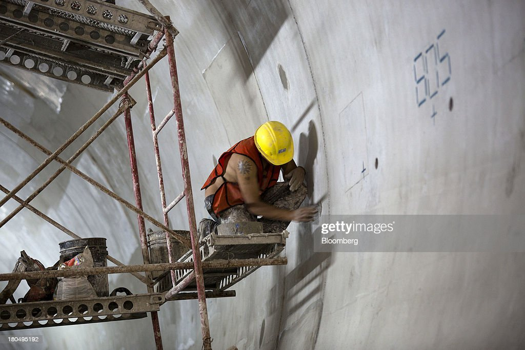 A man works on a scaffold inside the Tunnel Emisor Oriente (TEO), or Eastern Discharge Tunnel, during construction of the 38 mile (62km) underground wastewater treatment tunnel in Mexico City, Mexico, on Thursday, Sept. 12, 2013. The tunnel, which is expected to be completed in 2014, will boost Mexico City's drainage capacity to help prevent flooding during rainy season and the over-exploitation of groundwater resources. The project is being managed by Mexico's National Water Commission, Conagua. Photographer: Susana Gonzalez/Bloomberg via Getty Images