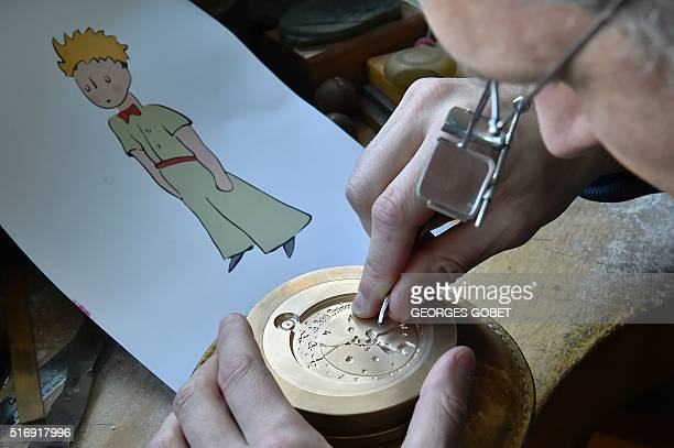 A man works on an etching mold displaying the Little Prince character on March 21 2016 at the Monnaie de Paris in Pessac western France The Monnaie...