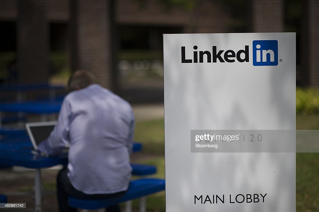 A man works on his computer outside of at LinkedIn Corp. headquarters in Mountain View, California, U.S., on Monday, July 28, 2014. LinkedIn Corp. is scheduled to release earnings figures on July 31. Photographer: David Paul Morris/Bloomberg via Getty Images