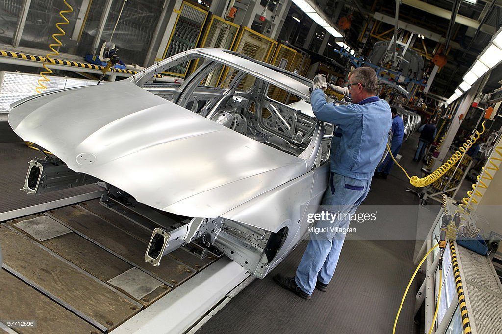 A man works on the car body on the BMW 3-series production line at the BMW factory on March 15, 2010 in Munich, Germany. The German car maker will present the company's business report for 2009 on Wednesday.
