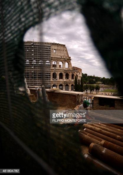 A man works on the construction site of the metro station with in a man works on the construction site of the metro station with in the background the scaffoldings of the colosseum coliseum during its restoration funded voltagebd Choice Image