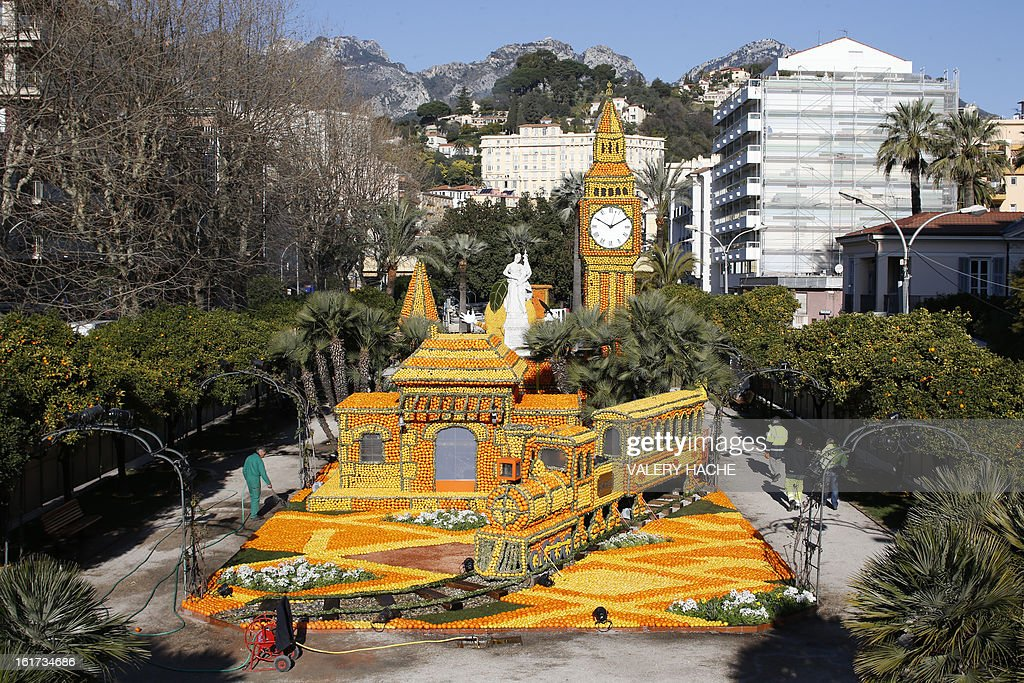 A man works on 'The rail road with Big Ben' a sculpture made of oranges and lemons, on February 15, 2013 in Menton on the French Riviera, ahead of the start of the 'Fete du Citron' (lemon carnival). The theme of this 80th edition, running from February 16 until March 6, 2013, is 'Le Tour du monde en 80 jours' (80 days around the world).