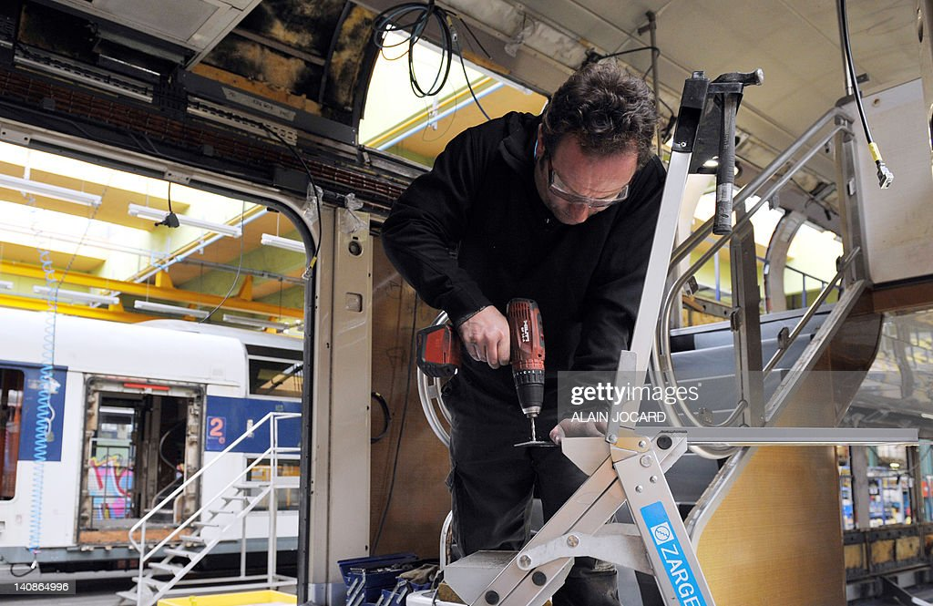 A man works on the renovation of a double-decker train RER (Regional Express Network) serving Paris and its suburbs, on March 7, 2012 in Saint-Pierre-des-Corps, central France.