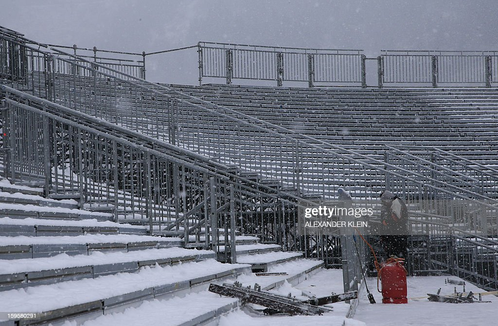 A man works on the terraces of the Planai ski stadium in Schladming, Austria on January 16, 2013 as part of the preparations for the FIS Ski World Championships. Schladming will host the next 2013 FIS Alpine Ski World Championship on February 4 to 17, 2013.