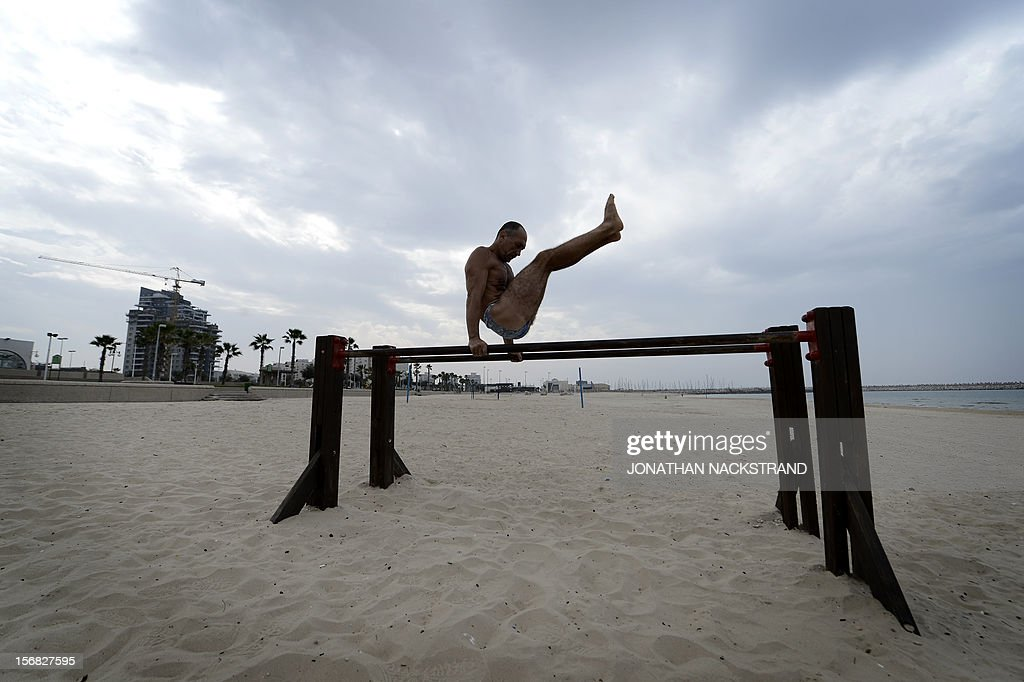 A man works out on a beach at the coastal Israeli city of Ashdod on November 22, 2012 a day after a cease fire was declared between the Jewish state and Hamas. Defence Minister Ehud Barak warned that Israel may resume its attacks on Gaza at any time if a truce that ended a week of bloodshed fails to hold.