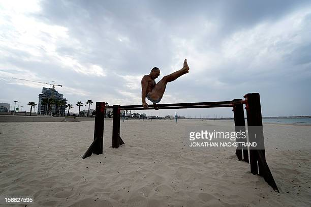 A man works out on a beach at the coastal Israeli city of Ashdod on November 22 2012 a day after a cease fire was declared between the Jewish state...