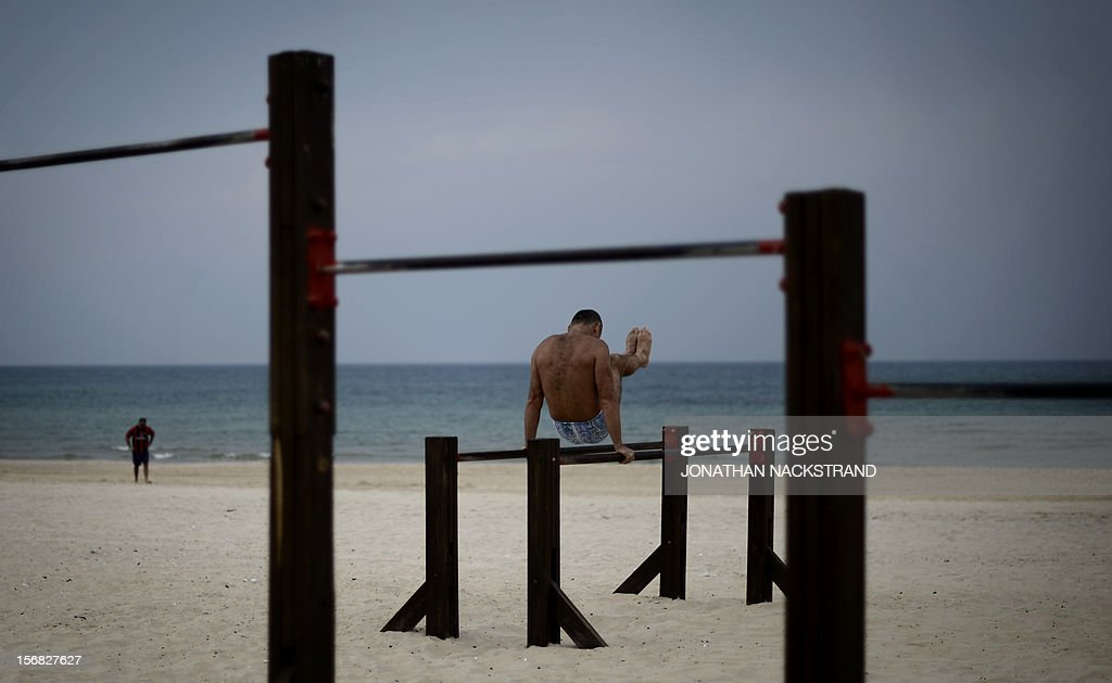 A man works out on a beach at the southern coastal Israeli city of Ashdod on November 22, 2012, a day after a cease fire was declared between the Jewish state and Hamas which controls the Gaza Strip. Defence Minister Ehud Barak warned that Israel may resume its attacks on Gaza at any time if a truce that ended a week of bloodshed fails to hold.