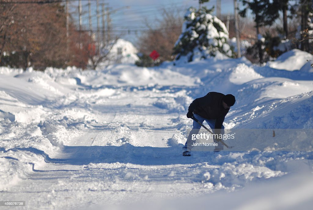 A man works to clear snow along old Milestrip road on November 20 2014 in the suburb of Blasdell Buffalo New York The record setting Lake effect...