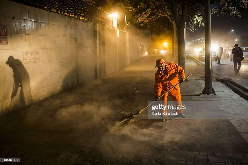 A man works to sweep a street on November 5, 2012 in Kabul, Afghanistan.