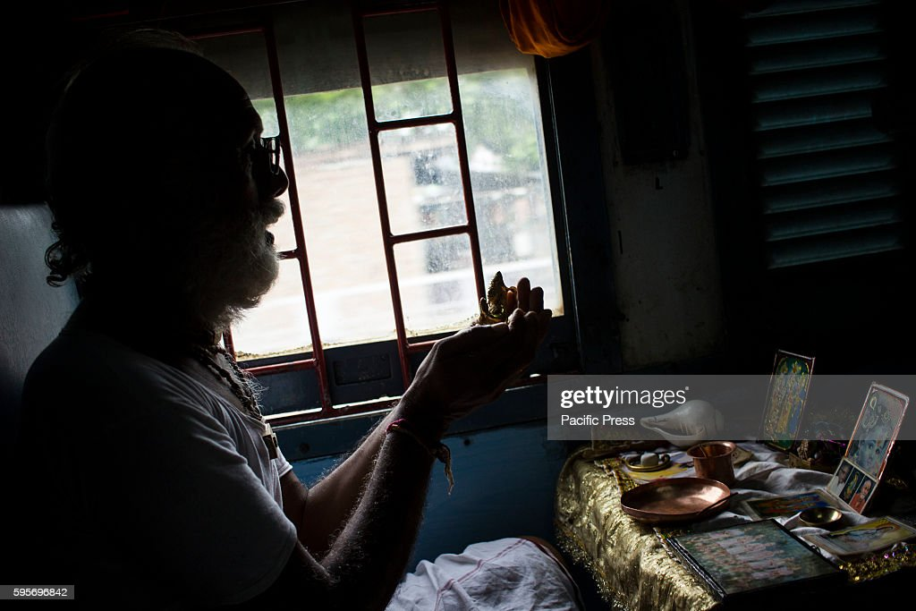 A man worshiping his deity with daily rituals while travelling in train to Mathura on Janmasthmi India is most diverse country in culture and belief...