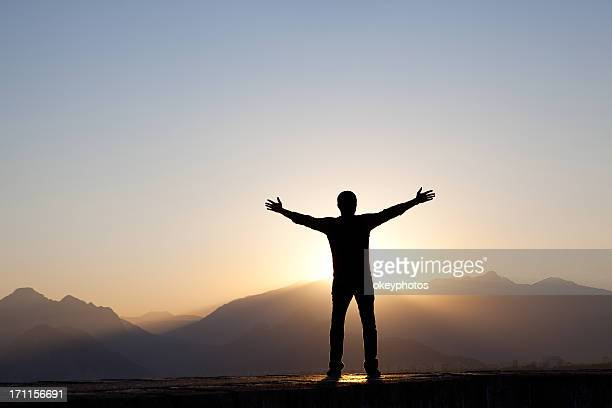 Man Worshipping at Sunrise